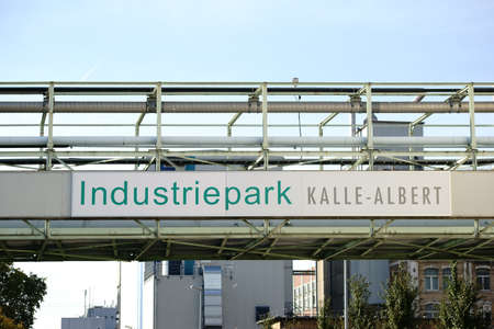 ag: Wiesbaden, Germany - October 02, 2015: The entrance sign of the industrial park Kalle-Albert of the Hoechst AG on October 02, 2015 in Wiesbaden.