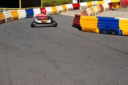 collisions: A racer in a kart driving on a limited kart track through the curve.