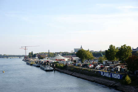 listeners: Mainz, Germany - October 02, 2015: The view over the river Rhine and the city of Mainz with a street food festival at the plank North on October 02, 2015 in Mainz.