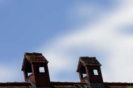 wiped out: The close-up of a bizarre brick chimney on the roof of a house.