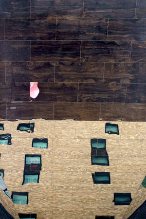 irregular shapes: The Reflection of windows and a facade in a ceiling of mirrors.