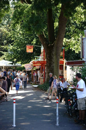 MAINZ: Mainz, Germany - August 29, 2015: Wine lovers and Art lovers visited the artists market on the Mainz Wine Market in the city park and rose garden on August 29, 2015 in Mainz. Editorial