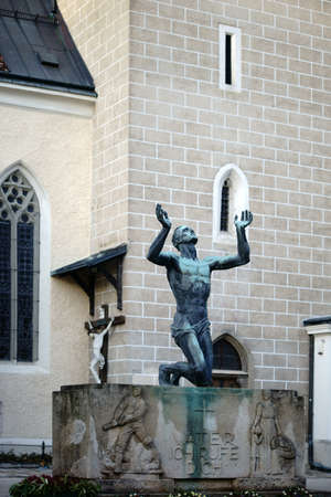caes: Baden near Vienna, Austria - November 14, 2015: The sculpture Father, Ill call you! In honor of the soldiers fall into World War II by the artist Josef Mller on November 14, 2015 in Baden near Vienna.