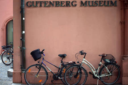 gutenberg: Mainz, Germany - September 4, 2015: Bicycles standing under the entrance sign of the Gutenberg Museum on September 4, 2015 in Mainz. Editorial