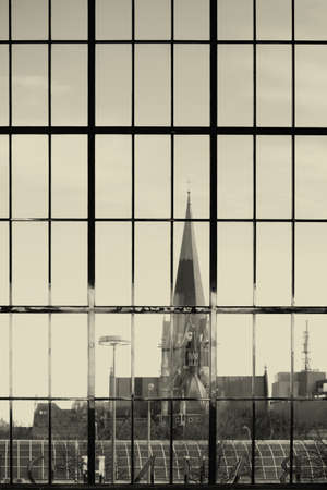 panoramic windows: Behind the panoramic windows of a train station is a church to see.