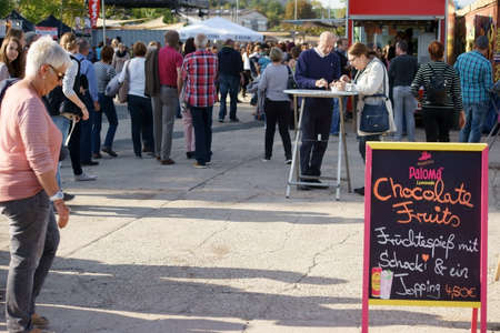 providers: Mainz, Germany - October 02, 2015: Teenage viewers and visitors standing on Food Stalls and bistro tables from various regional providers on October 02, 2015 in Mainz. Editorial