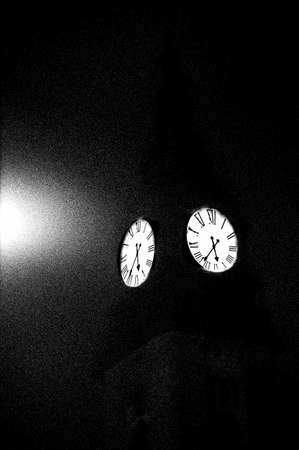 alienation: The surreal photograph of a church tower in the dark. Stock Photo