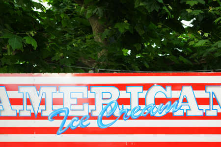 ice cream stand: The upper edge of an ice seller for American ice cream in the colors of the American flag.