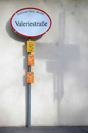 archduke: A nostalgic road sign of Archduke Valerie Street in Austria casts a shadow on the wall.