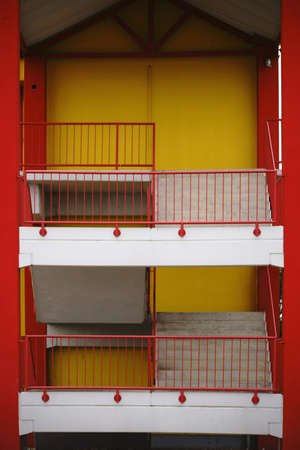 sidewall: A colorful and striking sidewall of a shopping center with an external staircase to the first floor. Stock Photo