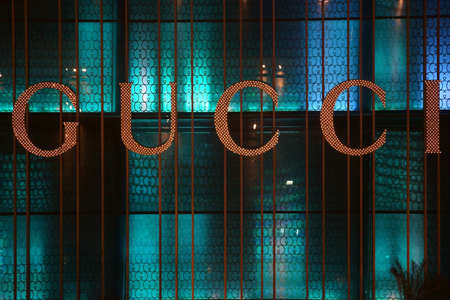 gucci: Las Vegas, USA - December 23, 2015: The illuminated window of a boutique with logo of the fashion label Gucci on December 23, 2015 in Las Vegas. Editorial