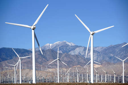 A wind turbine park in front of the the San Jacinto Peak or Mount San Jacinto near Palm Springs. Stock Photo
