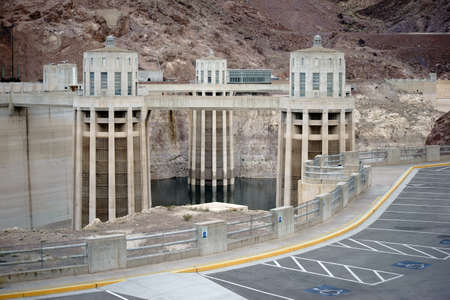 hoover dam: Boulder, United States - December 23, 2015: Three water intake towers of the Hoover Dam are in a dam in front of rock on 23 December 2015 in Boulder.