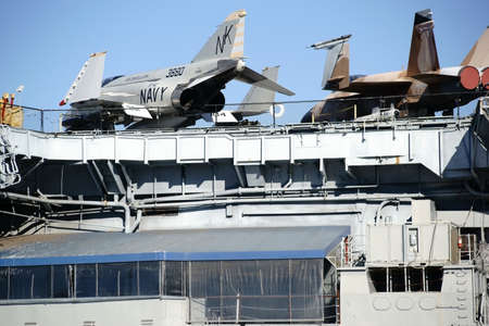 San Diego, United States - December 25, 2015: Three old warplanes standing on the deck of the aircraft carrier and museum ship MSS Midway in the Navy Pier on December 25, 2015 at the Port of San Diego. Editorial