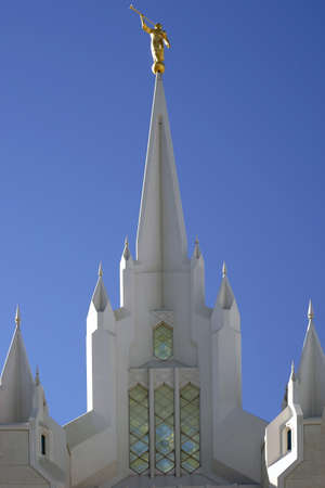 lds: San Diego, United States - December 25, 2015: A tower of the San Diego California Temple with a gold figure blowing the trumpet on the spire on December 25, 2015 in San Diego.