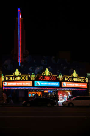 show business: Los Angeles, United States - December 27, 2015: The shop or a show business were the Guinness World Records are presented on Hollywood Boulevard at night on December 27, 2015 in Los Angeles.