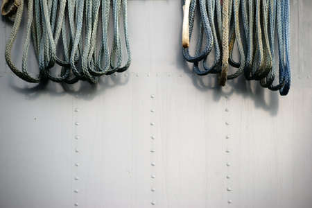 welds: Ropes hanging from the railing of a tanker on the vessel wall. Stock Photo