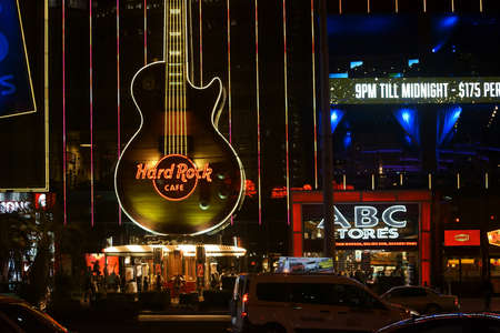 hard rock cafe: Las Vegas, USA - December 23, 2015: Road traffic and visitors in front of the lighted Hard Rock Cafe on the Las Vegas Boulevard in the night of December 23, 2015 in Las Vegas.