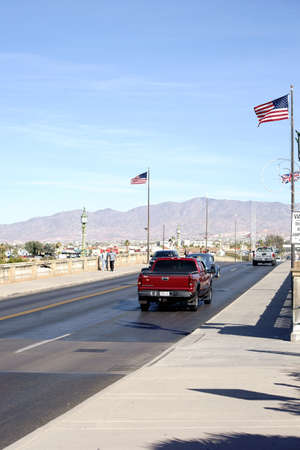 reproduced: Lake Havasu City, United States - December 23, 2015: Road traffic and pedestrians crossing the reconstructed London Bridge by Robert P. McCulloch on December 23, 2015 in Lake Havasu City.