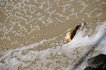 seawater: Seawater on the coast flows around rocks.