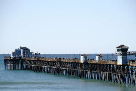 oceanside: Oceanside, United States - December 25, 2015: Visitors and Tourists walk in fine weather over the Oceanside Pier on December 25, 2015 in Oceanside.