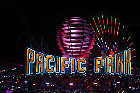 flashy: Santa Monica, USA - December 28, 2015: The flashy entrance sign of the amusement area Pacific Park on the Santa Monica Pier at night on December 28, 2015 in Santa Monica.