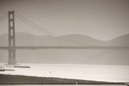 inclement: The Golden Gate Bridge in misty rainy weather and in monochrome.