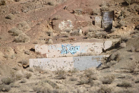 the residue: The remains of a house and its foundation in the desert. Stock Photo