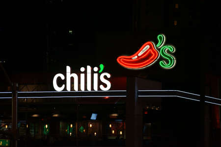chili's restaurant: Las Vegas, USA - December 23, 2015: The logo and the row of windows of the restaurant Chilis on the night of December 23, 2015 at the Las Vegas Boulevard in Las Vegas.