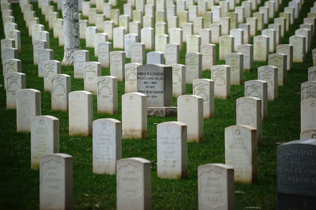 national military cemetery: San Francisco, United States - December 21, 2015: The National Cemetery of the United States in San Fransisco with graves of fallen soldiers and graves stones in a row on December 21, 2015 in San Francisco.
