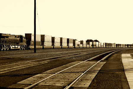 freight train: Needles, United States - December 23, 2015: A freight train with a General Electric Dash 9 Locomotive from the BNSF Railway Company and containers standing on a railway on December 23, 2015 Needles. Editorial