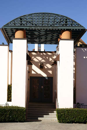 well maintained: San Juan Capistrano, United States - December 25, 2015: The decorated lattice-like canopy entrance to the San Juan Capistrano Library in sunny weather on December 25, 2015 in San Juan Capistrano.