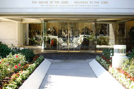 lds: San Diego, United States - December 25, 2015: The gold ornamented glass entrance of the San Diego California Temple with flower beds in front of the building on December 25, 2015 in San Diego. Editorial
