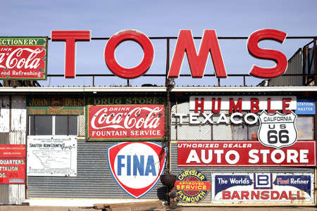barstow: Barstow, United States - December 22, 2015: A workshop with a large number of old vintage and retro label signs of different brands on December 22, 2015 in Barstow. Editorial
