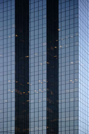 predominantly: The modern facade and exterior wall of a skyscraper predominantly consisting of glass. Stock Photo