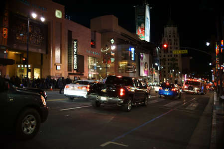Hollywood boulevard: Los Angeles, United States - December 27, 2015: A fire engine had a service at night on the Hollywood Boulevard with traffic on December 27, 2015 in Los Angeles.