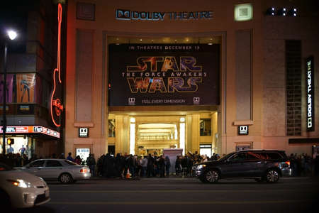 Hollywood boulevard: Los Angeles, United States - December 27, 2015: A queue of people is waiting outside the theater on Hollywood Boulevard to watch the movie Star Wars Rise of the power on the night of December 27, 2015 in Los Angeles. Editorial