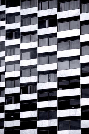 nested: Nested arranged window on a modern residential building and skyscraper