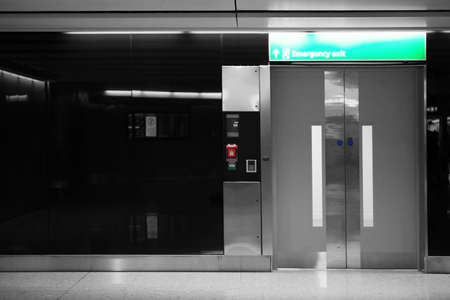 emergency exit: The glossy automatic door of an elevator is used as the emergency exit.