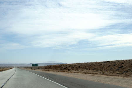 barstow: Distant traffic on a highway to Barstow in the Mojave Desert. Stock Photo