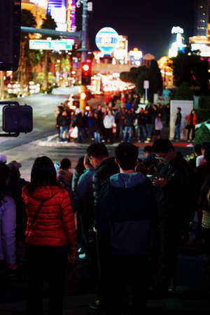 flashy: Las Vegas, USA - December 23, 2015: Crowds of tourists are standing at a traffic light on the flashy illuminated Las Vegas Boulevard on the night of December 23, 2015 in Las Vegas. Editorial