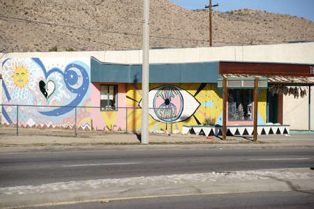 third eye: Yucca Valley, United States - December 24, 2015: The brightly painted facade of an old vintage shop in the desert southwest of California on December 24, 2015 in Yucca Valley.