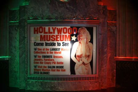 entrance sign: Los Angeles, United States - December 27, 2015: The night lit entrance sign of Hollywood Museum with a portrait of Marilyn Monroe on December 27, 2015 Los Angeles.