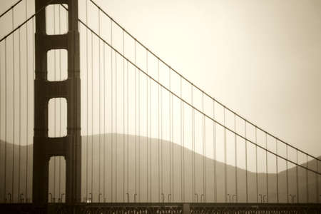 inclement: The vintage photograph of a pillar of the Golden Gate Bridge in misty rain. Stock Photo