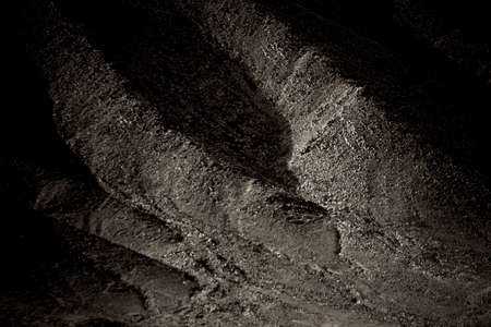 striking: A dark mountainside of rugged and striking rock formations.