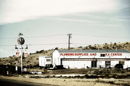barstow: Barstow, United States - December 22, 2015: A sales shop for plumbing accessories in the desert near Barstow with old vintage and retro signs on December 22, 2015 in Barstow.