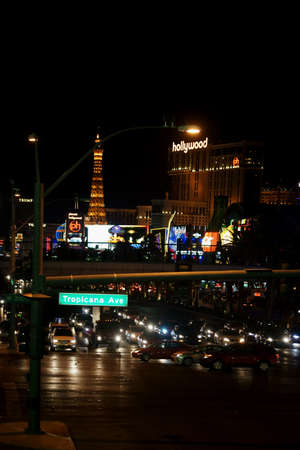 tropicana: Las Vegas, USA - December 23, 2015: Traffic on Las Vegas Boulevard corner Tropicana Avenue with a collection of casinos and luxury hotels in the night of December 23, 2015 in Las Vegas.