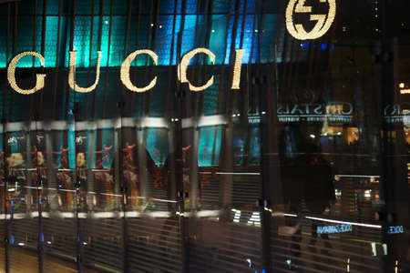gucci store: Las Vegas, USA - December 23, 2015: Abstract reflections in a glass passage in front of the shop window of the boutique and fashion label Gucci on December 23, 2015 in Las Vegas. Editorial