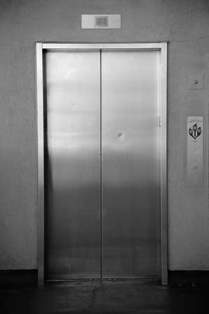 sliding doors: The close-up of a passenger elevator with automatic sliding doors.