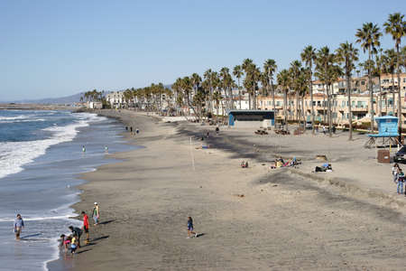 december 25: Oceanside, United States - December 25, 2015: Visitors and tourists enjoying Themselves in fine weather at the beach of Oceanside on December 25, 2015 in Oceanside. Editorial